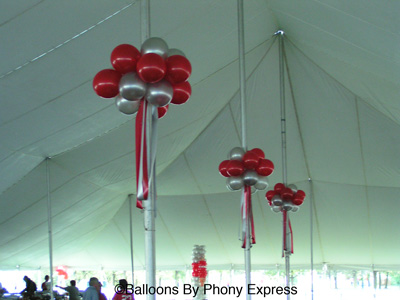Helium balloon clusters accent the tent posts. & Football u0026 Tailgate Theme Events