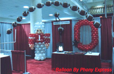this trade show booth illustrates several football theme decorations an 8 foot tall football player 6 foot tall balloon block o with internal lights and - Football Decorations
