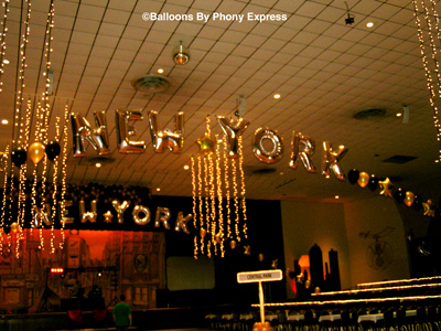 new york new york arches combine latex and foil letter and star balloons over the immense dance floor